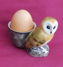 Owl with egg cup (chicken)
