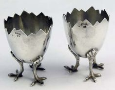 silver eggcup with three legs?